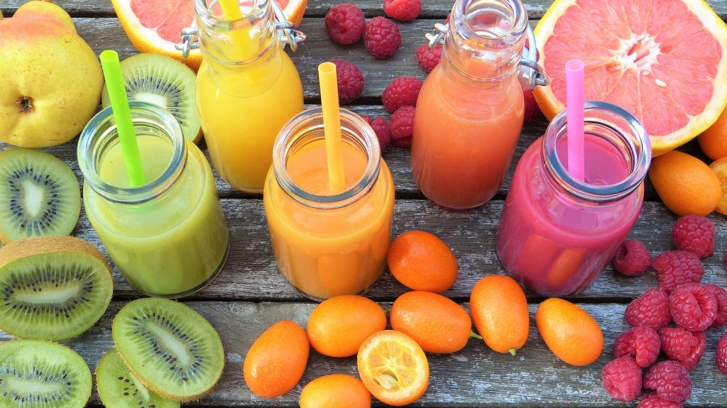 Healthy fruit juices and smoothies,kiwi,kumquat and raspberries